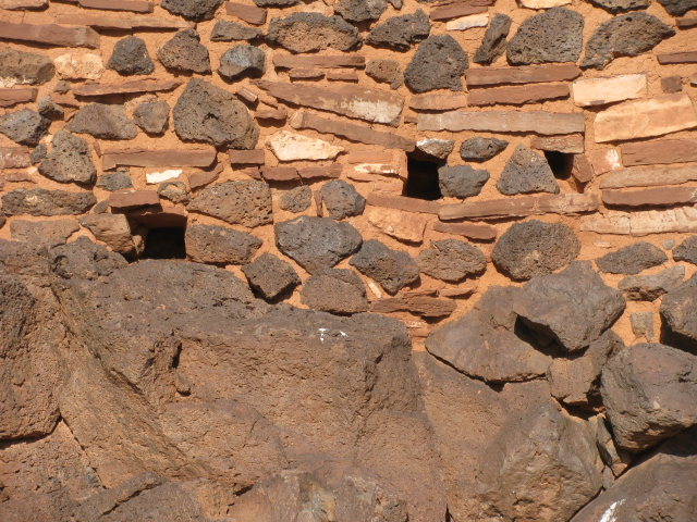 Built on Basalt outcrops with walls of sandstone and basalt